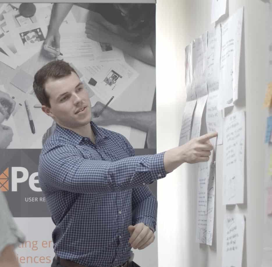 Man coaching others in UX