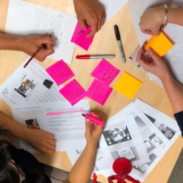 Group of in-house training students creating prototypes